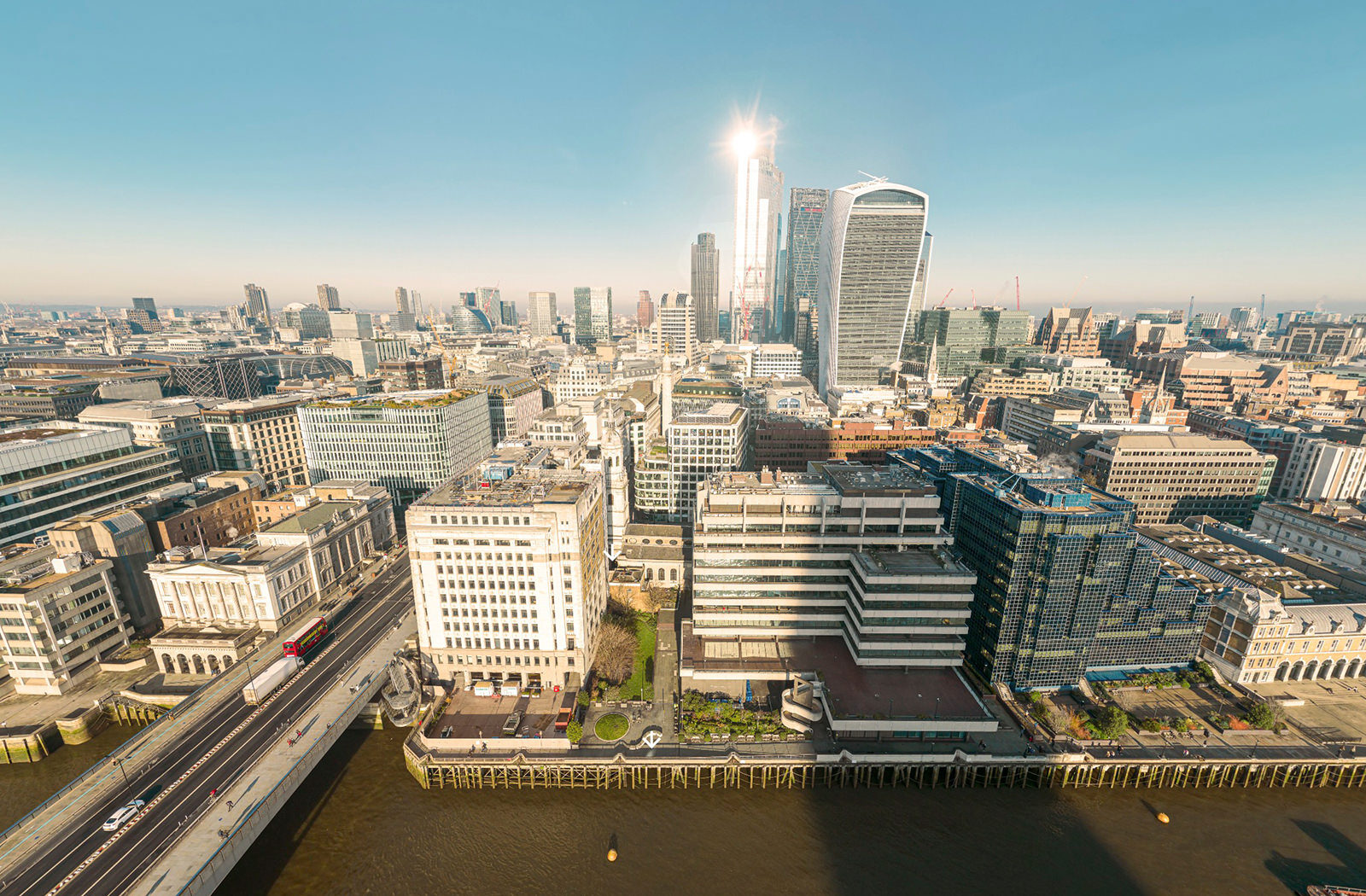 Still image taken from the aerial 360 for the St Magnus Church virtual tour. The image is taken from high above the River Thames and shows London Bridge, St Magnus the Martyr and Adelaide house, with the City of London in view behind them.